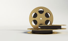 Film reel with a film strip Royalty Free Stock Photography