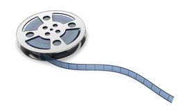 Film reel with filmstrip. Filmstrips coming out of its reel on white background Royalty Free Stock Photo