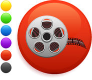 Film reel icon on round internet button. 