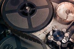 Film reel inside old-fashioned retro movie camera mechanism Royalty Free Stock Image