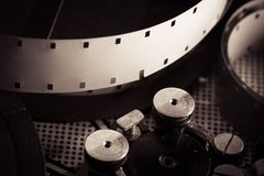 Film reel inside old-fashioned retro movie camera mechanism Stock Photography