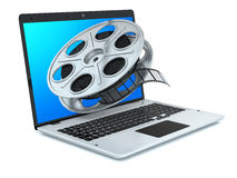 Film reel and laptop. Stock Photo