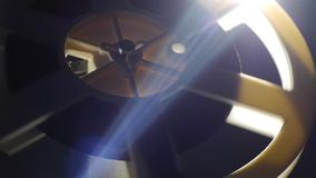 Film reel - Lens And Light Beam - Includes film projector audio stock footage