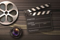 Clapperboards and the reel of film. Film reel, lens and movie clapper in retro composition Stock Photography
