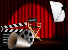 Film reel with megaphone and director chair Royalty Free Stock Photos