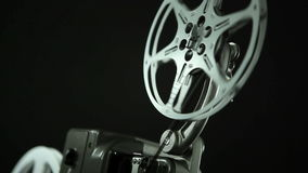 Film Reel 8mm black. Film reel of an 8mm vintage Projector and black background stock video footage
