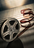 Film reel. Motion picture film reel on the table Royalty Free Stock Images