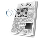 Film reel with newspaper. Isolated on white background Stock Photo