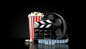 Film reel with popcorn. On black background Royalty Free Stock Images