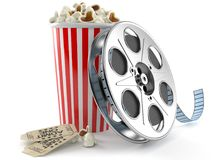 Film reel with popcorn. Isolated on white background Royalty Free Stock Photo