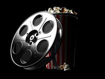 Film reel with popcorn isolated. On black background Royalty Free Stock Photography