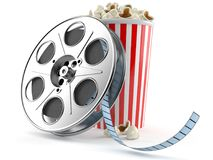 Film reel with popcorn. Isolated on white background Royalty Free Stock Photography
