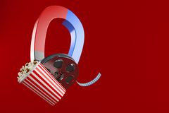 Film reel with popcorn and magnet. On red background royalty free illustration