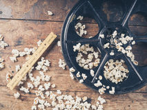 Film reel with popcorn and tickets. Cinema concept of vintage film reel with popcorn and movie tickets Stock Photography