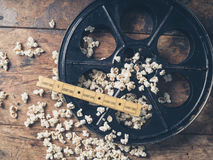 Film reel with popcorn and tickets. Cinema concept of vintage film reel with popcorn and movie tickets Royalty Free Stock Photos