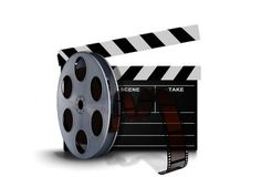 Film reel roll with clapperboard Royalty Free Stock Image