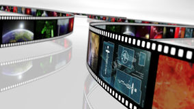 Film reel with science fiction based concepts. An image of some film reels with a variety of illustrations in space sci-fi style stock illustration