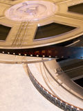Film reel series 11. Movie reels with film strips royalty free stock images