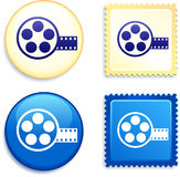Film Reel on Stamp and Button Stock Photography