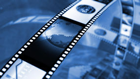 Film reel with stock market images. An image of film reels with a variety of clips. Illustrations of the stock market and the news, with world globes. In black Stock Photography