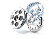 Film reel with stopwatch. On white background Royalty Free Stock Photography
