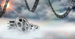 Film reels against sky in background Stock Photos