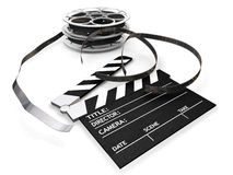Film reels and clapper board. 3D render of film reels and a clapper board isolated on white background Stock Photography