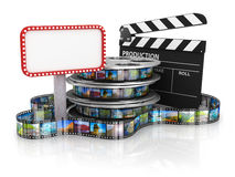 Film Reels and Clapper board and cardboard Royalty Free Stock Photo