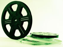 Film reels with films. Green tone photo of film reels with film stock image