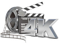 Film reels and movie clapper board. 4K video icon. 3D render. Illustration  on white background Stock Photography