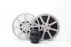 Film reels of old movies and black dummy head Royalty Free Stock Image
