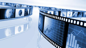 Film reels with stock market concepts. An image of film reels with a variety of clips. Illustrations of the stock market and the news, with world globes. In Royalty Free Stock Image