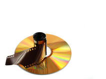 Film roll. And compact disk on white background royalty free stock images