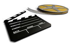 Film Roll And Clapboard. Ambience of cinematography Stock Photo