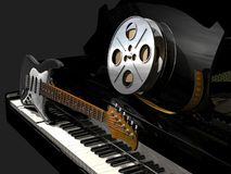 Film roll, piano and electric guitar royalty free stock photos