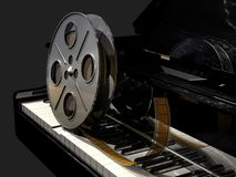 Film roll on a piano keyboard stock photos