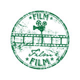 Film rubber stamp. Green grunge rubber stamp with film strip, old camera shape and the word film written inside the stamp Stock Photography
