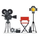 Film set director chair. Film directors chair with megaphone, projector, camera and clapboard. Work on the set of the film. Flat vector cartoon illustration Royalty Free Stock Images