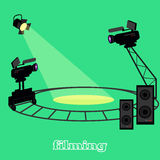 Film Shootings Camera and Projector. Equipment for filming, professional camera on circular rails, it is glowing a bright spotlight and speakers for sound  in Stock Image