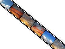 Film with sky photographs. Over white background Stock Images