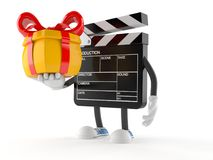 Film slate character holding gift. On white background Stock Images