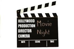 Film slate - film clapperboard. Movie Night as title royalty free stock photo