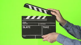 Film slate on green screen stock footage