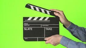 Film slate on green screen