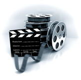 Film Slate with Movie Film Reel. 3d rendered image Stock Image