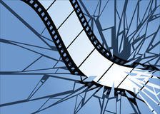 Film Smash. Film strip smashing through a surface Royalty Free Stock Image