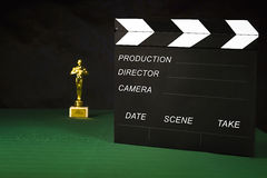 The film spank and the statuette Royalty Free Stock Photo