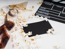 the film in the spiral, near the popcorn, Clapperboard copy space for text, fashion highlights in the photo, concept, film industr stock image