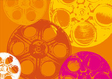 Film spools orange. Full and empty colored film spools in orange background Royalty Free Stock Photos