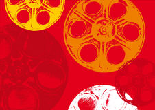 Film spools red. Full and empty colored film spools in red background Stock Images